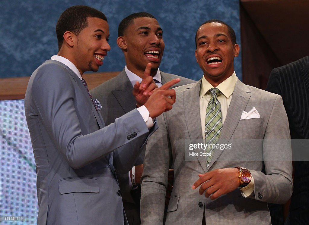 Michael Carter-Williams of Syracuse, Otto Porter of Georgetown and C.J. McCollum of Lehigh share a laugh on stage prior to the start of the 2013 NBA Draft at Barclays Center on June 27, 2013 in in the Brooklyn Bourough of New York City.