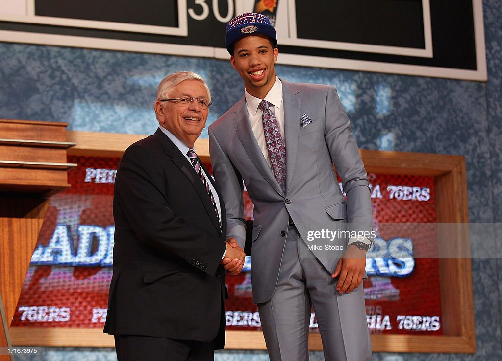 <a gi-track='captionPersonalityLinkClicked' href=/galleries/search?phrase=Michael+Carter-Williams&family=editorial&specificpeople=7621167 ng-click='$event.stopPropagation()'>Michael Carter-Williams</a> (R) of Syracuse poses for a photo with NBA Commissioner <a gi-track='captionPersonalityLinkClicked' href=/galleries/search?phrase=David+Stern&family=editorial&specificpeople=206848 ng-click='$event.stopPropagation()'>David Stern</a> after Carter-Williams was drafted #11 overall in the first round by the Philadelphia 76ers during the 2013 NBA Draft at Barclays Center on June 27, 2013 in in the Brooklyn Bourough of New York City.