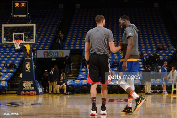 Michael CarterWilliams of the Chicago Bulls shakes hands with Draymond Green of the Golden State Warriors before the game on February 8 2017 at...