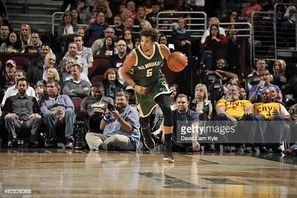 Michael CarterWilliams of the Milwaukee Bucks brings the ball up court against the Cleveland Cavaliers on October 13 2015 at Quicken Loans Arena in...