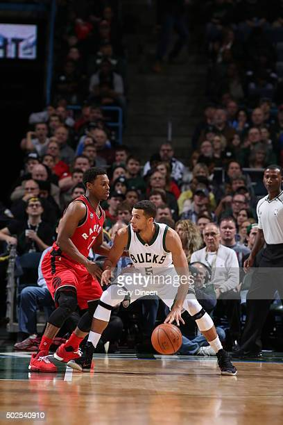 Michael CarterWilliams of the Milwaukee Bucks defends the ball against the Toronto Raptors during the game on December 26 2015 at BMO Harris Bradley...