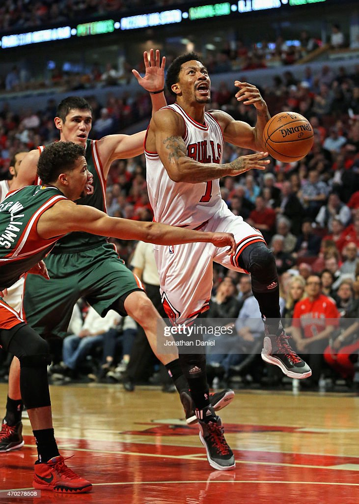 <a gi-track='captionPersonalityLinkClicked' href=/galleries/search?phrase=Michael+Carter-Williams&family=editorial&specificpeople=7621167 ng-click='$event.stopPropagation()'>Michael Carter-Williams</a> #5 of the Milwaukee Bucks knocks the ball away from <a gi-track='captionPersonalityLinkClicked' href=/galleries/search?phrase=Derrick+Rose&family=editorial&specificpeople=4212732 ng-click='$event.stopPropagation()'>Derrick Rose</a> #1 of the Chicago Bulls after he had driven past <a gi-track='captionPersonalityLinkClicked' href=/galleries/search?phrase=Ersan+Ilyasova&family=editorial&specificpeople=557070 ng-click='$event.stopPropagation()'>Ersan Ilyasova</a> #7 during the first round of the 2015 NBA Playoffs at the United Center on April 18, 2015 in Chicago, Illinois. The Bulls defeated the Bucks 103-91.