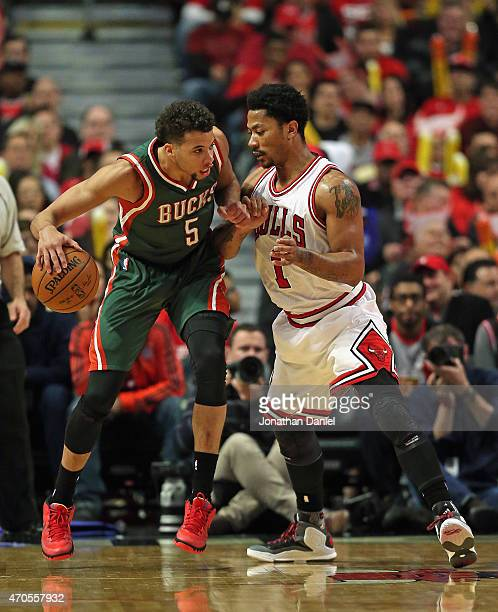 Michael CarterWilliams of the Milwaukee Bucks moves against Derrick Rose of the Chicago Bulls during the first round of the 2015 NBA Playoffs at the...