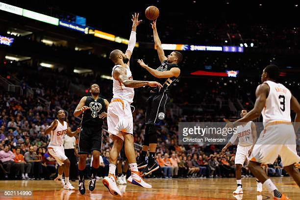 Michael CarterWilliams of the Milwaukee Bucks puts up a shot over Tyson Chandler of the Phoenix Suns during the first half of the NBA game at Talking...