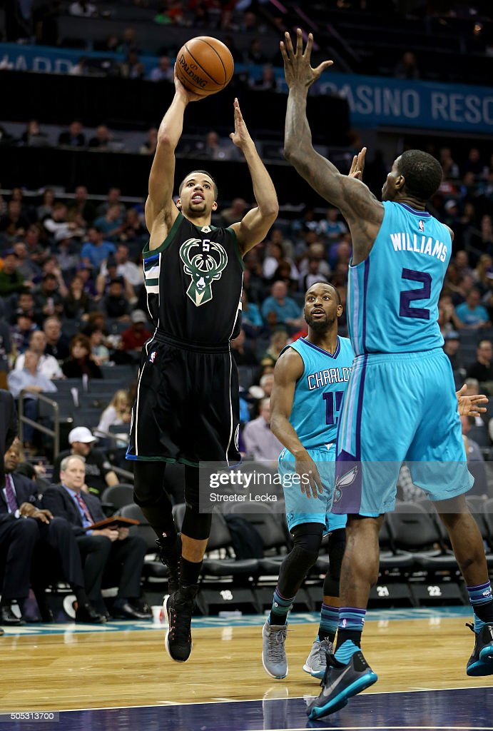 Michael Carter-Williams #5 of the Milwaukee Bucks shoots over Marvin Williams #2 of the Charlotte Hornets during their game at Time Warner Cable Arena on January 16, 2016 in Charlotte, North Carolina.