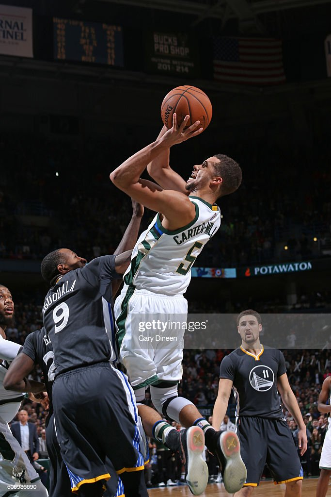 <a gi-track='captionPersonalityLinkClicked' href=/galleries/search?phrase=Michael+Carter-Williams&family=editorial&specificpeople=7621167 ng-click='$event.stopPropagation()'>Michael Carter-Williams</a> #5 of the Milwaukee Bucks shoots the ball during the game tate Warriors on December 12, 2015 at the BMO Harris Bradley Center in Milwaukee, Wisconsin.
