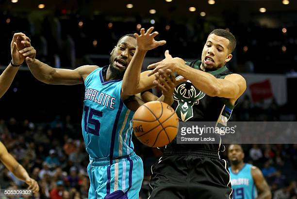 Michael CarterWilliams of the Milwaukee Bucks tries to grab a loose ball against Kemba Walker of the Charlotte Hornets during their game at Time...