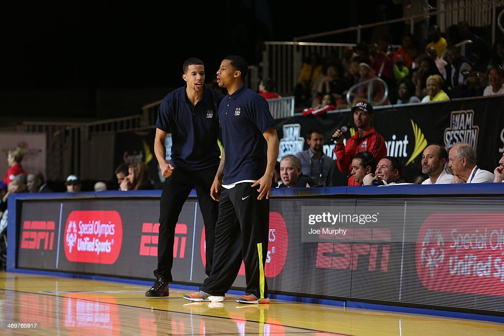 Michael Carter-Williams of the Philadelphia 76ers and Coach of the East Team and Trey Burke of the Denver Nuggets and Coach of the West Team react to a play during the NBA Cares Special Olympics Unified Sports Basketball Game at Sprint Arena during the 2014 NBA All-Star Jam Session at the Ernest N. Morial Convention Center on February 16, 2014 in New Orleans, Louisiana.