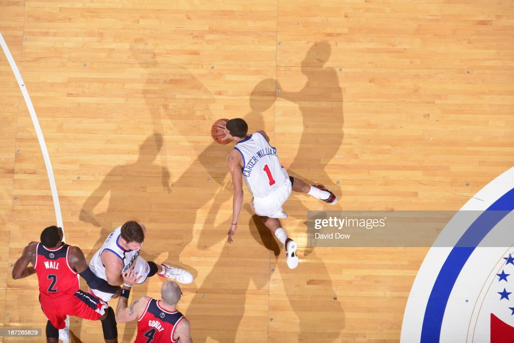 <a gi-track='captionPersonalityLinkClicked' href=/galleries/search?phrase=Michael+Carter-Williams&family=editorial&specificpeople=7621167 ng-click='$event.stopPropagation()'>Michael Carter-Williams</a> #1 of the Philadelphia 76ers dribbles the ball against the Washington Wizards on November 6, 2013 in Philadelphia, Pennsylvania.