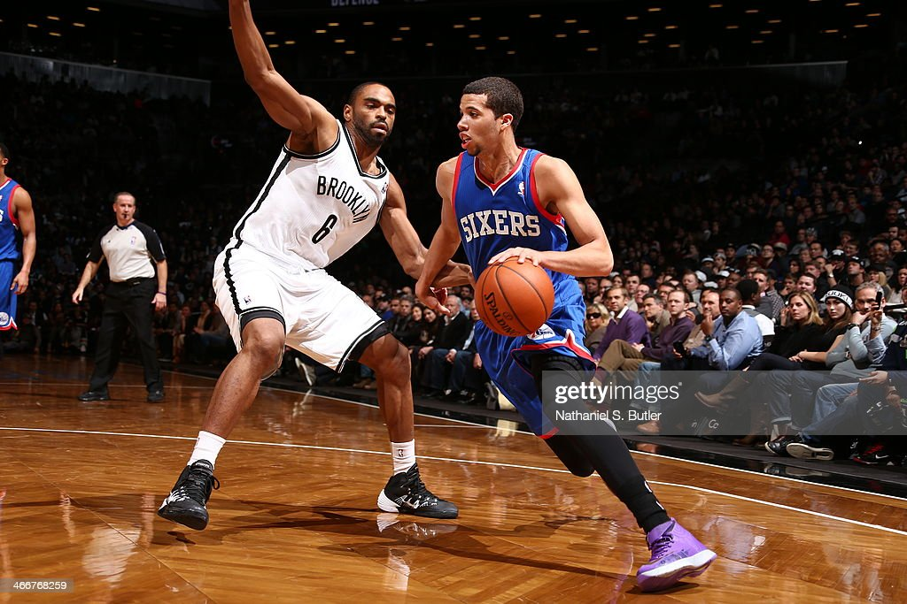 <a gi-track='captionPersonalityLinkClicked' href=/galleries/search?phrase=Michael+Carter-Williams&family=editorial&specificpeople=7621167 ng-click='$event.stopPropagation()'>Michael Carter-Williams</a> #1 of the Philadelphia 76ers drives against Alan Anderson #6 of the Brooklyn Nets during a game at Barclays Center in Brooklyn.