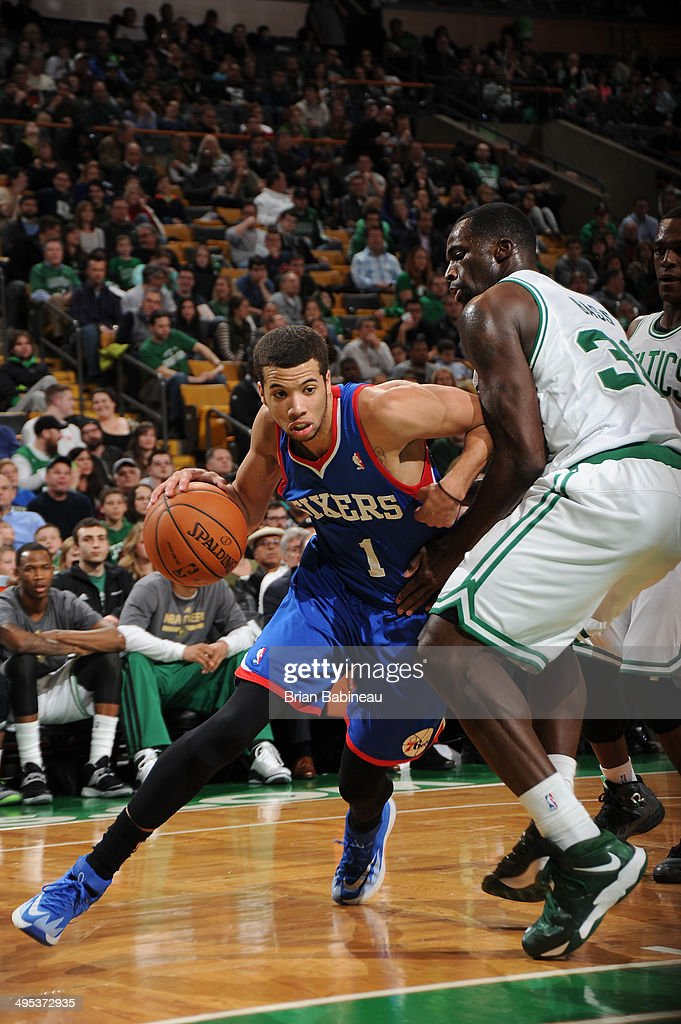 <a gi-track='captionPersonalityLinkClicked' href=/galleries/search?phrase=Michael+Carter-Williams&family=editorial&specificpeople=7621167 ng-click='$event.stopPropagation()'>Michael Carter-Williams</a> #1 of the Philadelphia 76ers drives to the basket against Brandon Bass #30 of the Boston Celtics on April 4, 2014 at the TD Garden in Boston, Massachusetts.