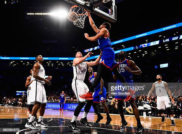 Michael CarterWilliams of the Philadelphia 76ers dunks over Mason Plumlee of the Brooklyn Nets in the second quarter at the Barclays Center on...