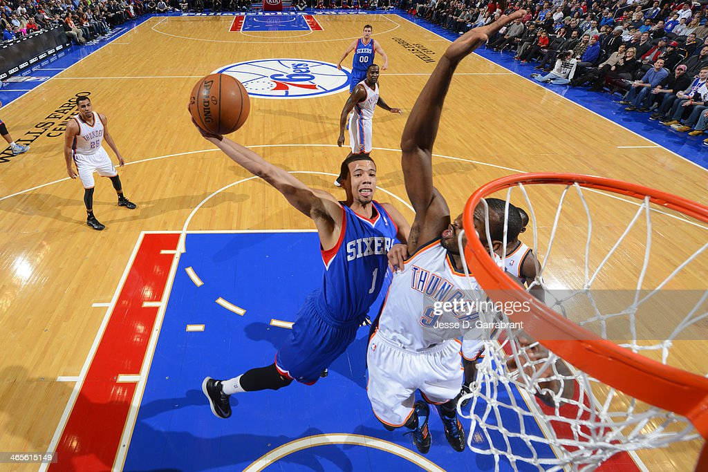 <a gi-track='captionPersonalityLinkClicked' href=/galleries/search?phrase=Michael+Carter-Williams&family=editorial&specificpeople=7621167 ng-click='$event.stopPropagation()'>Michael Carter-Williams</a> #1 of the Philadelphia 76ers dunks the ball against the Oklahoma City Thunder at the Wells Fargo Center on January 25, 2014 in Philadelphia, Pennsylvania.