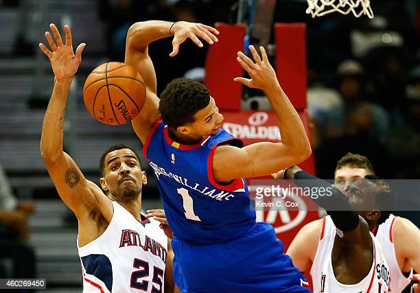 Michael CarterWilliams of the Philadelphia 76ers has the ball stripped by Thabo Sefolosha and Dennis Schroder of the Atlanta Hawks at Philips Arena...
