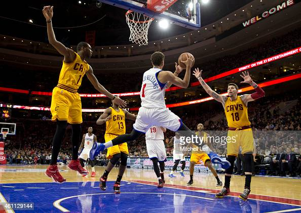 Michael CarterWilliams of the Philadelphia 76ers looks to pass the ball with James Jones and Mike Miller of the Cleveland Cavaliers defending on the...