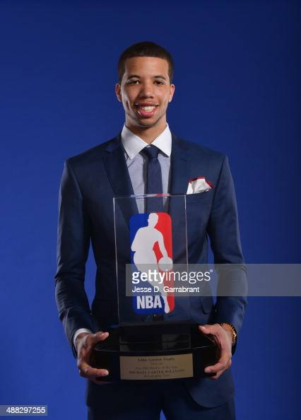 Michael CarterWilliams of the Philadelphia 76ers poses for portrait with the Eddie Gottlieb Trophy for being named the 201314 Kia NBA Rookie of the...