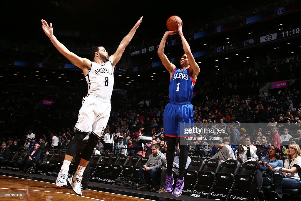 <a gi-track='captionPersonalityLinkClicked' href=/galleries/search?phrase=Michael+Carter-Williams&family=editorial&specificpeople=7621167 ng-click='$event.stopPropagation()'>Michael Carter-Williams</a> #1 of the Philadelphia 76ers shoots against Deron Williams #8 of the Brooklyn Nets during a game at Barclays Center in Brooklyn.