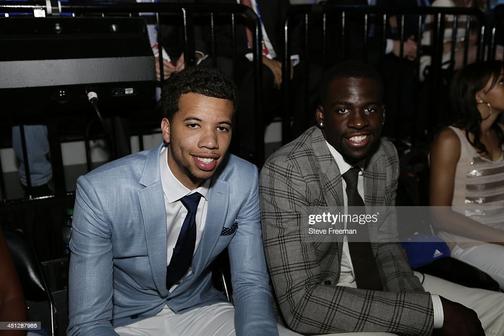 Michael Carter-Williams of the Philadelphia 76ers smiles with Draymond Green of the Golden State Warriors during the 2014 NBA Draft on June 26, 2014 at the Barclays Center in Brooklyn New York.