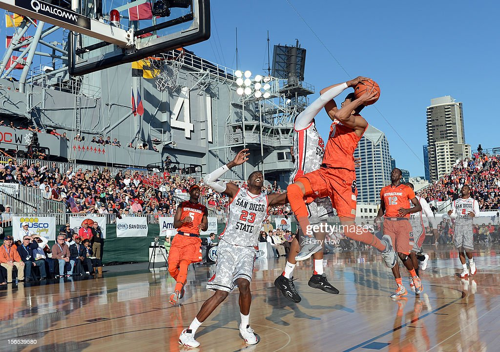 Michael Carter-Williams #1 of the Syracuse Orange attempts a shot in front of Chase Tapley #22 and Deshawn Stephens #23 of the San Diego State Aztecs during a 62-49 Syracuse win on the USS Midway on November 11, 2012 in San Diego, California.