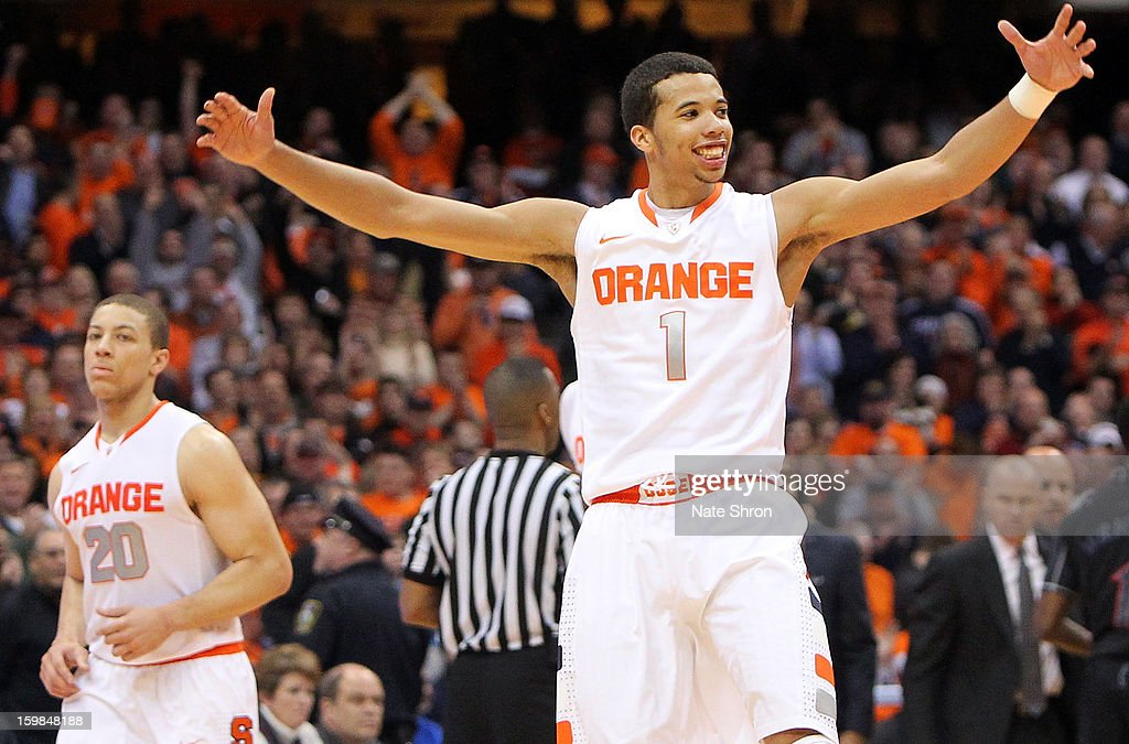 <a gi-track='captionPersonalityLinkClicked' href=/galleries/search?phrase=Michael+Carter-Williams&family=editorial&specificpeople=7621167 ng-click='$event.stopPropagation()'>Michael Carter-Williams</a> #1 of the Syracuse Orange celebrates after a play during the game against the Cincinnati Bearcats at the Carrier Dome on January 21, 2013 in Syracuse, New York.