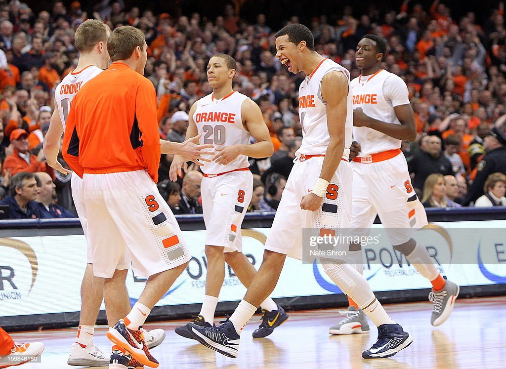 <a gi-track='captionPersonalityLinkClicked' href=/galleries/search?phrase=Michael+Carter-Williams&family=editorial&specificpeople=7621167 ng-click='$event.stopPropagation()'>Michael Carter-Williams</a> #1 of the Syracuse Orange celebrates with teamates <a gi-track='captionPersonalityLinkClicked' href=/galleries/search?phrase=Brandon+Triche&family=editorial&specificpeople=6516120 ng-click='$event.stopPropagation()'>Brandon Triche</a> #20, Trevor Cooney #10, Jerami Grant #3 and Griffin Hoffman #13 after a play during the game against the Cincinnati Bearcats at the Carrier Dome on January 21, 2013 in Syracuse, New York.
