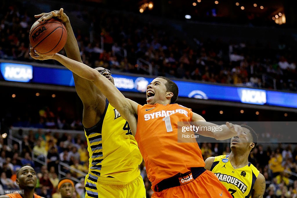 <a gi-track='captionPersonalityLinkClicked' href=/galleries/search?phrase=Michael+Carter-Williams&family=editorial&specificpeople=7621167 ng-click='$event.stopPropagation()'>Michael Carter-Williams</a> #1 of the Syracuse Orange draws contact against <a gi-track='captionPersonalityLinkClicked' href=/galleries/search?phrase=Chris+Otule&family=editorial&specificpeople=5678342 ng-click='$event.stopPropagation()'>Chris Otule</a> #42 of the Marquette Golden Eagles during the East Regional Round Final of the 2013 NCAA Men's Basketball Tournament at Verizon Center on March 30, 2013 in Washington, DC.