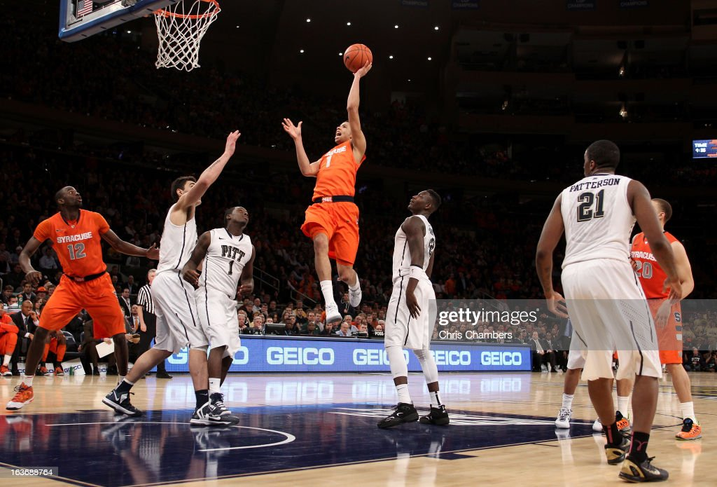 Michael Carter-Williams #1 of the Syracuse Orange drives for a shot attempt in the second half against the Pittsburgh Panthers during the quaterfinals of the Big East Men's Basketball Tournament at Madison Square Garden on March 14, 2013 in New York City.