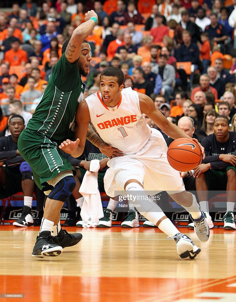 Michael Carter-Williams #1 of the Syracuse Orange drives to the basket against Kenneth Ortiz #15 of the Wagner Seahawks during the game at the Carrier Dome on November 18, 2012 in Syracuse, New York.