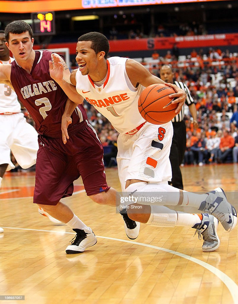 Michael Carter-Williams #1 of the Syracuse Orange drives to the basket against Mitch Rolls #2 of the Colgate Raiders during the game at the Carrier Dome on November 25, 2012 in Syracuse, New York.
