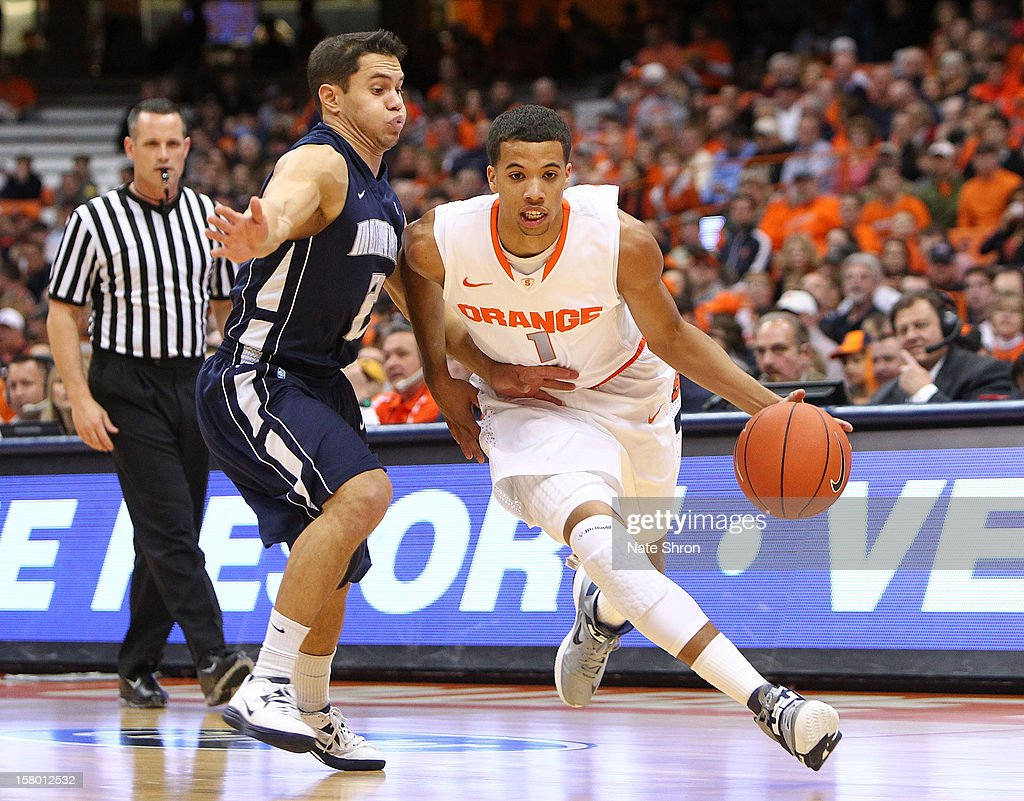 Michael Carter-Williams #1 of the Syracuse Orange drives to the basket against Jesse Steele #2 of the Monmouth Hawks during the game at the Carrier Dome on December 8, 2012 in Syracuse, New York.