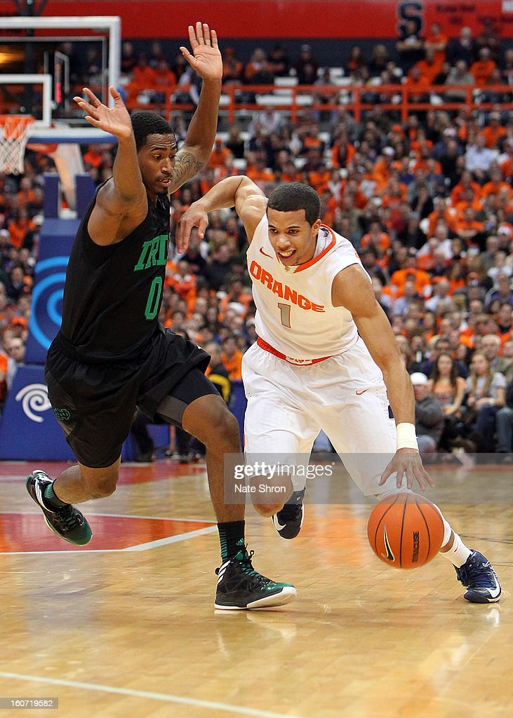 Michael Carter-Williams #1 of the Syracuse Orange drives to the basket against Eric Atkins #0 of the Notre Dame Fighting Irish during the game at the Carrier Dome on February 4, 2013 in Syracuse, New York.