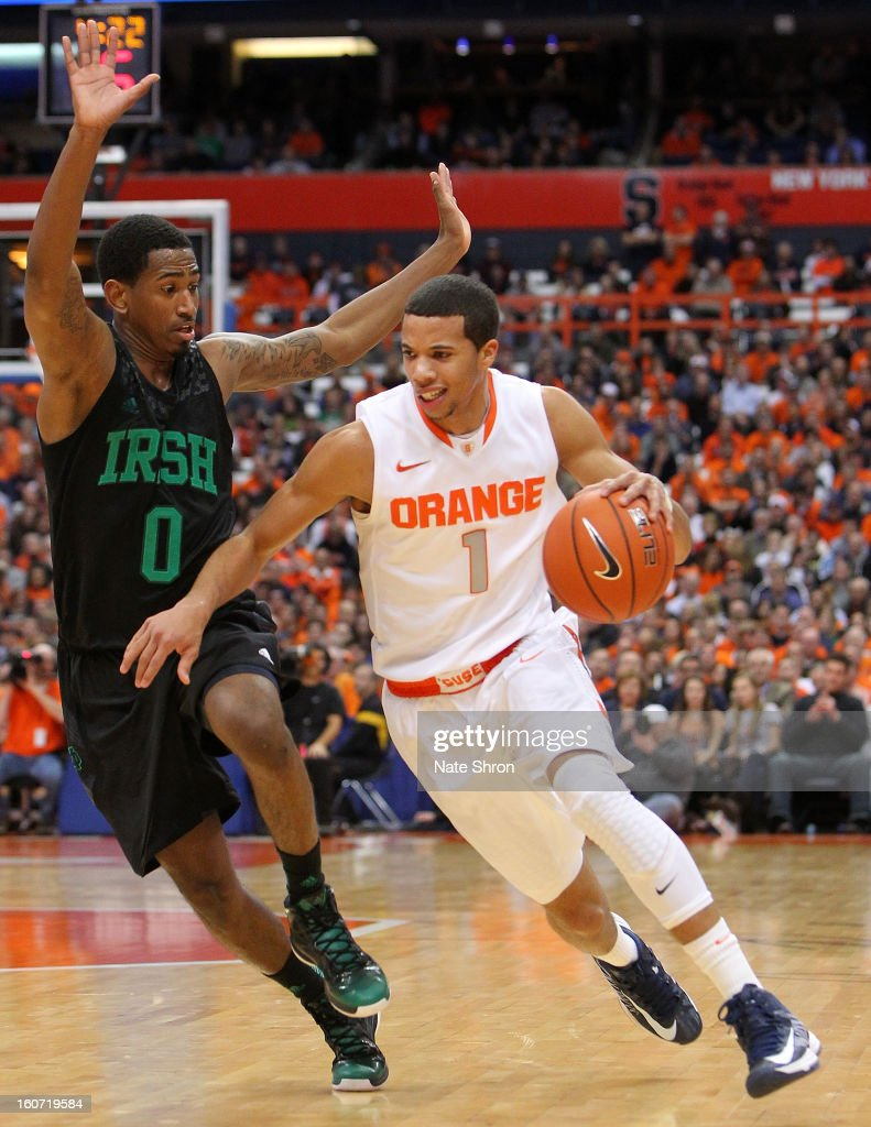 <a gi-track='captionPersonalityLinkClicked' href=/galleries/search?phrase=Michael+Carter-Williams&family=editorial&specificpeople=7621167 ng-click='$event.stopPropagation()'>Michael Carter-Williams</a> #1 of the Syracuse Orange drives to the basket against <a gi-track='captionPersonalityLinkClicked' href=/galleries/search?phrase=Eric+Atkins&family=editorial&specificpeople=7379862 ng-click='$event.stopPropagation()'>Eric Atkins</a> #0 of the Notre Dame Fighting Irish during the game at the Carrier Dome on February 4, 2013 in Syracuse, New York.