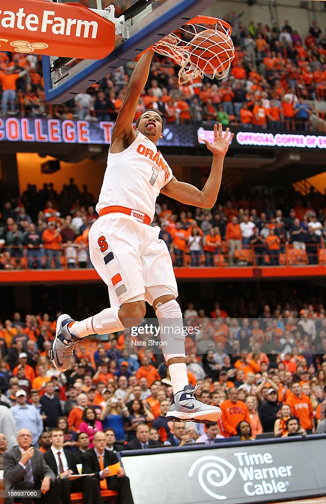 Michael Carter-Williams #1 of the Syracuse Orange dunks the ball against the Colgate Raiders during the game at the Carrier Dome on November 25, 2012 in Syracuse, New York.