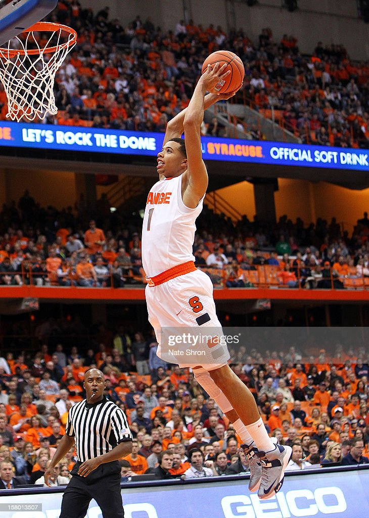 Michael Carter-Williams #1 of the Syracuse Orange dunks the ball during the game against the Monmouth Hawks at the Carrier Dome on December 8, 2012 in Syracuse, New York.