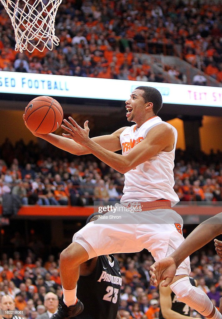 <a gi-track='captionPersonalityLinkClicked' href=/galleries/search?phrase=Michael+Carter-Williams&family=editorial&specificpeople=7621167 ng-click='$event.stopPropagation()'>Michael Carter-Williams</a> #1 of the Syracuse Orange goes up for a shot against the Providence Friars during the game at the Carrier Dome on February 20, 2013 in Syracuse, New York.