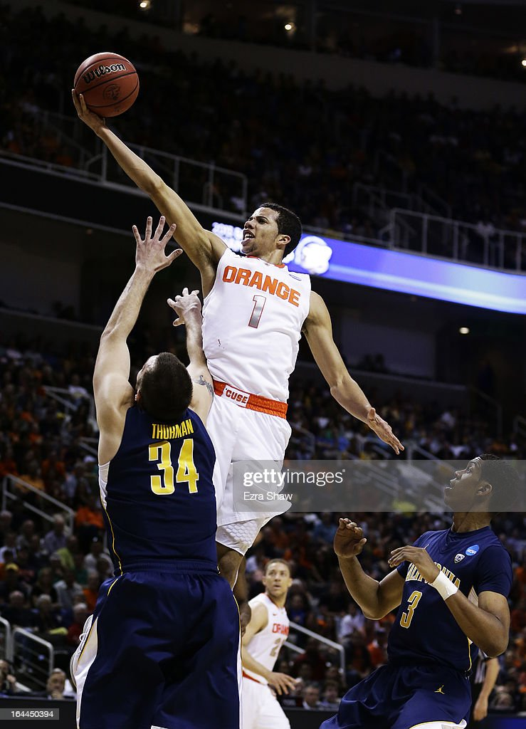 Michael Carter-Williams #1 of the Syracuse Orange goes up over Robert Thurman #34 of the California Golden Bears in the first half during the third round of the 2013 NCAA Men's Basketball Tournament at HP Pavilion on March 23, 2013 in San Jose, California.