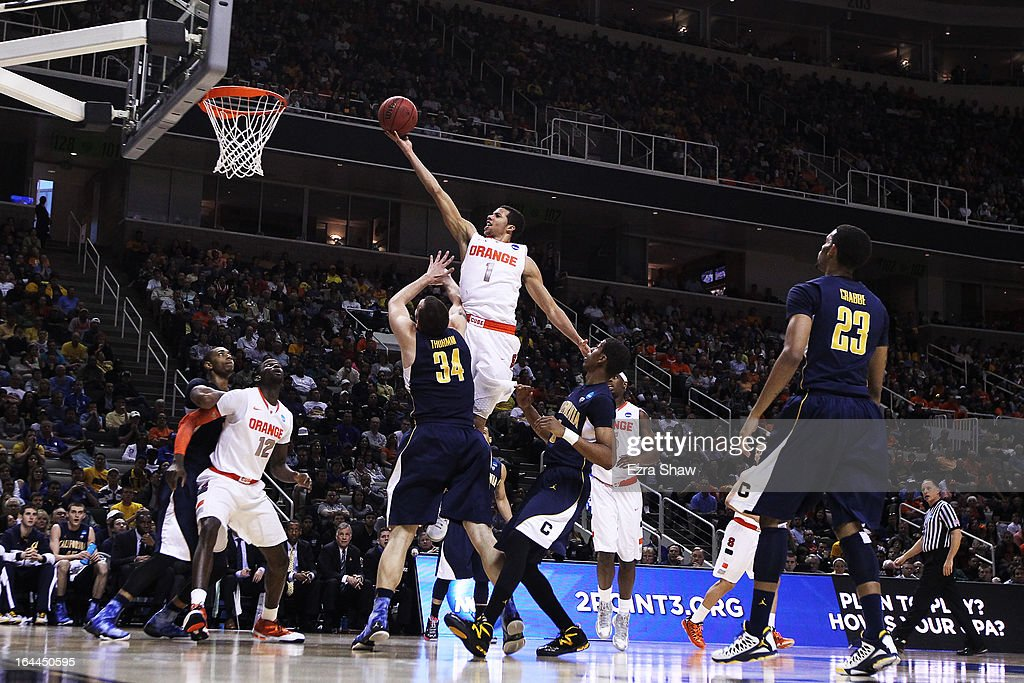 <a gi-track='captionPersonalityLinkClicked' href=/galleries/search?phrase=Michael+Carter-Williams&family=editorial&specificpeople=7621167 ng-click='$event.stopPropagation()'>Michael Carter-Williams</a> #1 of the Syracuse Orange goes up over Robert Thurman #34 of the California Golden Bears in the first half during the third round of the 2013 NCAA Men's Basketball Tournament at HP Pavilion on March 23, 2013 in San Jose, California.