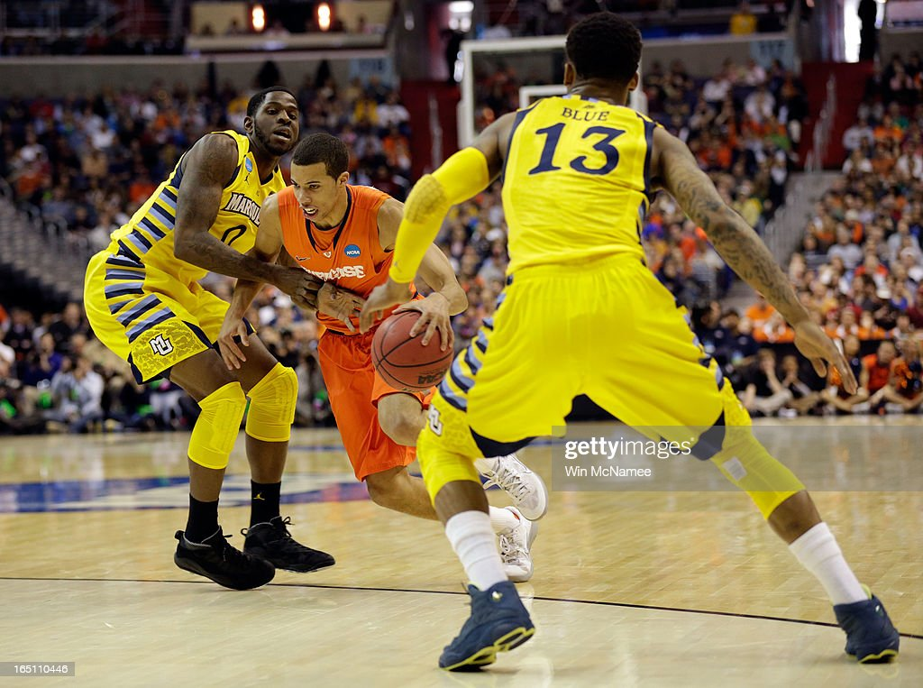Michael Carter-Williams #1 of the Syracuse Orange handles the ball against Vander Blue #13 and Jamil Wilson #0 of the Marquette Golden Eagles during the East Regional Round Final of the 2013 NCAA Men's Basketball Tournament at Verizon Center on March 30, 2013 in Washington, DC.