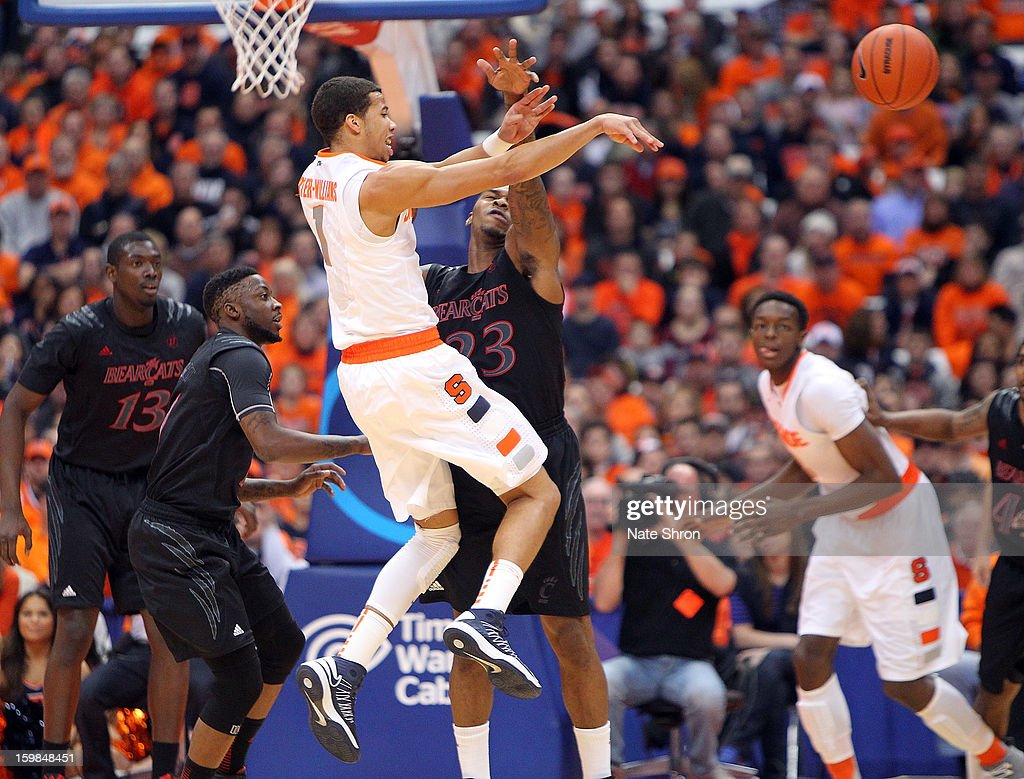 Michael Carter-Williams #1 of the Syracuse Orange passes the ball against Sean Kilpatrick #23 of the Cincinnati Bearcats during the game at the Carrier Dome on January 21, 2013 in Syracuse, New York.