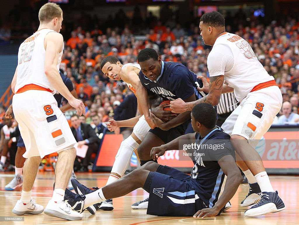 <a gi-track='captionPersonalityLinkClicked' href=/galleries/search?phrase=Michael+Carter-Williams&family=editorial&specificpeople=7621167 ng-click='$event.stopPropagation()'>Michael Carter-Williams</a> #1 of the Syracuse Orange reaches for the ball as teamates Trevor Cooney #10 and DaJuan Coleman #32 look on against Mouphtaou Yarou #13 and JayVaughn Pinkston #22 of the Villanova Wildcats during the game at the Carrier Dome on January 12, 2013 in Syracuse, New York.