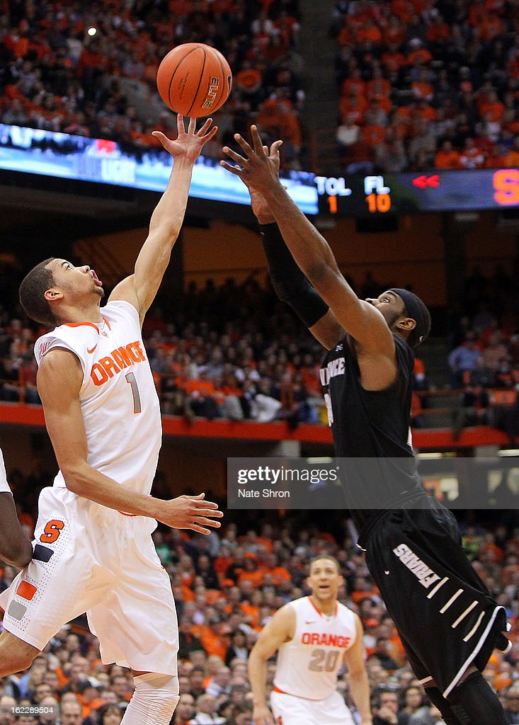 Michael Carter-Williams #1 of the Syracuse Orange reaches for the rebound against LaDontae Henton #23 of the Providence Friars during the game at the Carrier Dome on February 20, 2013 in Syracuse, New York.