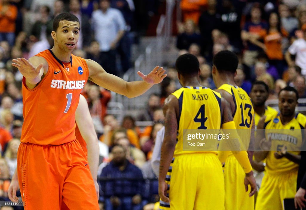 Michael Carter-Williams #1 of the Syracuse Orange reacts after a call against the Marquette Golden Eagles during the East Regional Round Final of the 2013 NCAA Men's Basketball Tournament at Verizon Center on March 30, 2013 in Washington, DC.