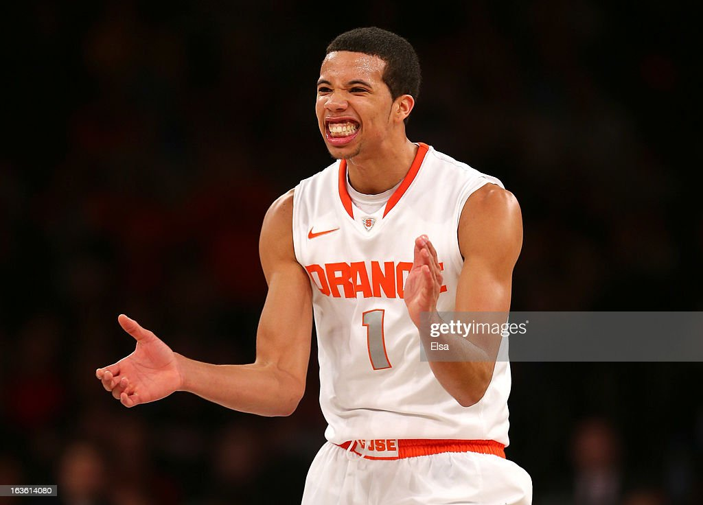 <a gi-track='captionPersonalityLinkClicked' href=/galleries/search?phrase=Michael+Carter-Williams&family=editorial&specificpeople=7621167 ng-click='$event.stopPropagation()'>Michael Carter-Williams</a> #1 of the Syracuse Orange reacts after a play in the second half against the Seton Hall Pirates during the second round of the Big East Tournament at Madison Square Garden on March 13, 2013 in New York City.