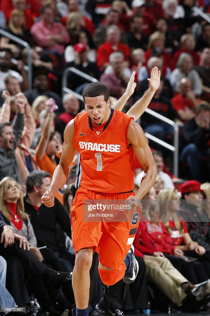 <a gi-track='captionPersonalityLinkClicked' href=/galleries/search?phrase=Michael+Carter-Williams&family=editorial&specificpeople=7621167 ng-click='$event.stopPropagation()'>Michael Carter-Williams</a> #1 of the Syracuse Orange reacts after hitting a three-point shot against the Louisville Cardinals during the game at KFC Yum! Center on January 19, 2013 in Louisville, Kentucky. Syracuse defeated Louisville 70-68.
