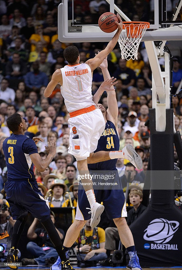 <a gi-track='captionPersonalityLinkClicked' href=/galleries/search?phrase=Michael+Carter-Williams&family=editorial&specificpeople=7621167 ng-click='$event.stopPropagation()'>Michael Carter-Williams</a> #1 of the Syracuse Orange shoots over Robert Thurman #34 of the California Golden Bears in the first half during the third round of the 2013 NCAA Men's Basketball Tournament at HP Pavilion on March 23, 2013 in San Jose, California.