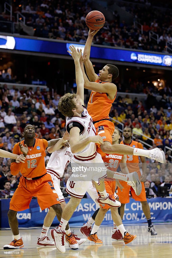 <a gi-track='captionPersonalityLinkClicked' href=/galleries/search?phrase=Michael+Carter-Williams&family=editorial&specificpeople=7621167 ng-click='$event.stopPropagation()'>Michael Carter-Williams</a> #1 of the Syracuse Orange shoots the ball over Jordan Hulls #1 of the Indiana Hoosiers during the East Regional Round of the 2013 NCAA Men's Basketball Tournament at Verizon Center on March 28, 2013 in Washington, DC.