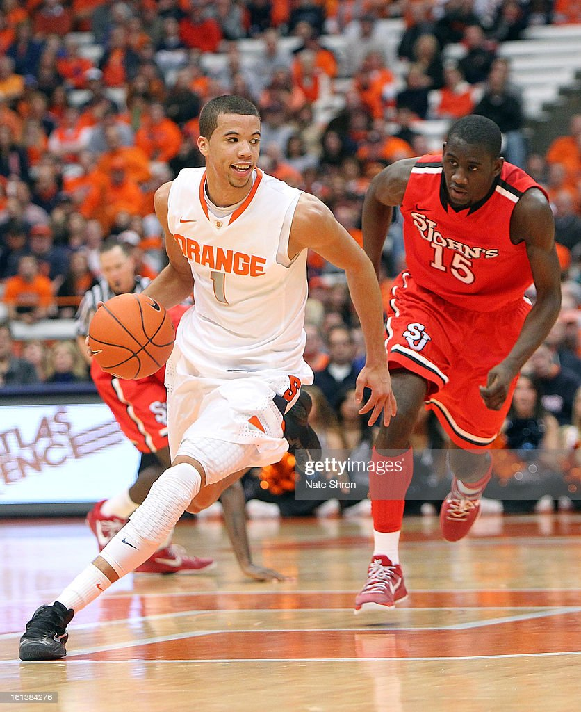 Michael Carter-Williams #1 of the Syracuse Orange takes the ball down the court against Sir'Dominic Pointer #15 of the St. John's Red Storm during the game at the Carrier Dome on February 10, 2013 in Syracuse, New York.