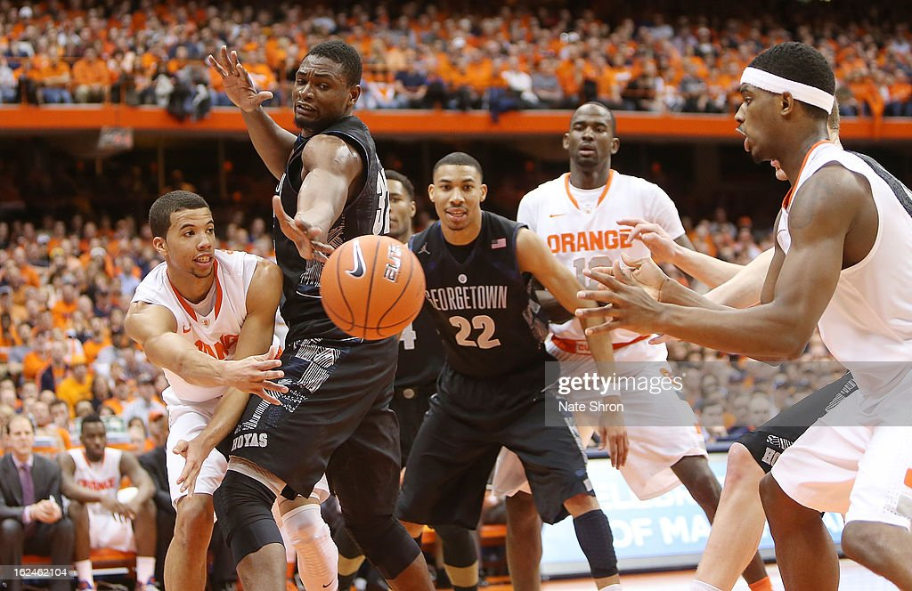 Michael Carter-Willimas #1 of the Syracuse Orange passes the ball as teamates Baye Moussa-Keita #12 and C.J. Fair #5 look on against Moses Ayegba #32 and Otto Porter Jr. #22 of the Georgetown Hoyas during the game at the Carrier Dome on February 23, 2013 in Syracuse, New York.