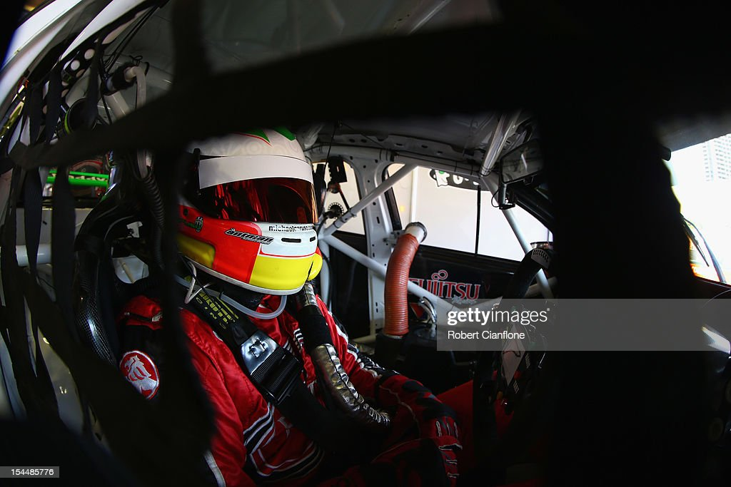 Michael Caruso driver of the #34 Fujitsu Racing GRM Holden sits in his car prior to qualifying for the Gold Coast 600, which is round 12 of the V8 Supercars Championship Series at the Gold Coast Street Circuit on October 21, 2012 on the Gold Coast, Australia.