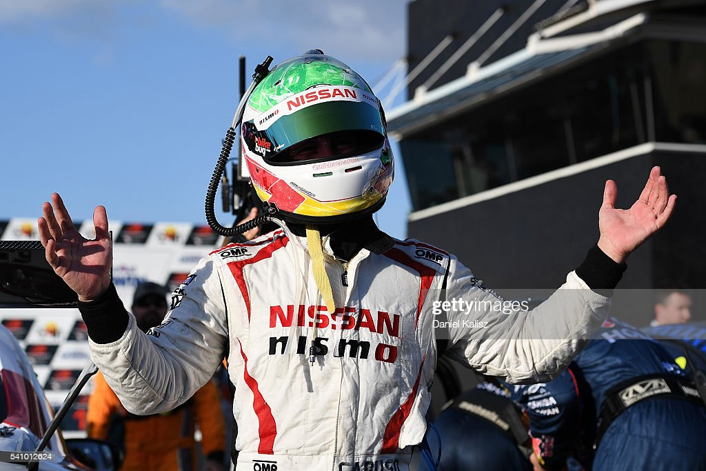 Michael Caruso driver of the Nissan Motorsport Nissan Altima celebrates after winning race 1 for the V8 Supercars Darwin Triple Crown at Hidden...
